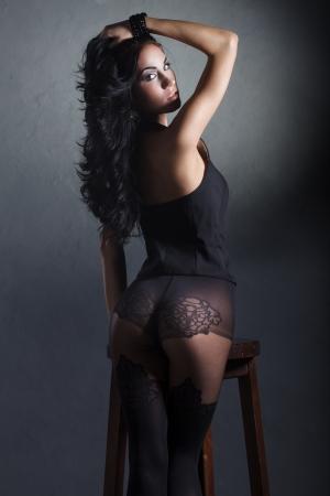 sexy brunette girl in black lingerie and nylon stockings Stock Photo