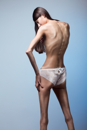 penetrating: Part of woman body suffering anorexia nervosa Stock Photo