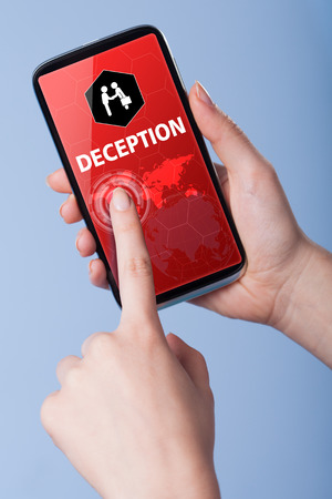 deception: Man presses a touch screen smart phone with the symbol of an deception. Business, technology, internet concept.