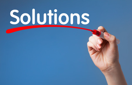 Hand writing Solutions red marker on transparent wipe board.Business, technology, internet concept. Banque d'images