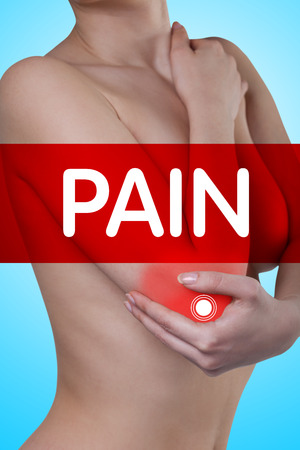 elbow pain: A man holding his elbow. Pain in the elbow joint.Pain.