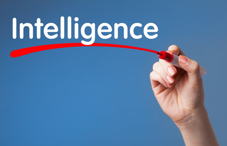 Hand writing Intelligence red marker on transparent wipe board.Business, technology, internet concept. photo