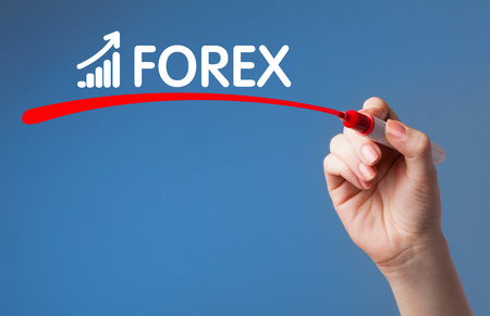 Hand writing Forex red marker on transparent wipe board.Business, technology, internet concept. photo
