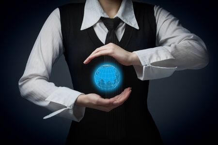 offshoring: Businesswoman offer map of the world representing global market and globalization. Stock Photo