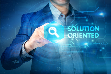 oriented: Business, internet, technology concept. Businessman chooses Solution Oriented button on a touch screen interface.
