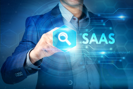 Business, internet, technology concept. Businessman chooses SAAS button on a touch screen interface.