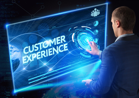 Business, Technology, Internet and network concept. Technology future. Young businessman, working on the smartphone of the future, clicks on the virtual display button: Customer Experience