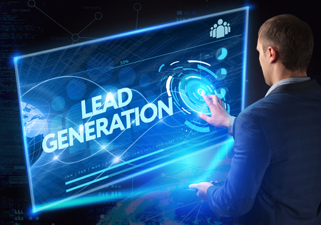 patron: Business, Technology, Internet and network concept. Technology future. Young businessman, working on the smartphone of the future, clicks on the virtual display button: Lead Generation Stock Photo
