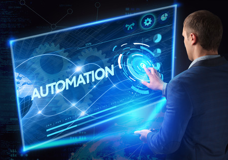 Business, Technology, Internet and network concept. Technology future. Young businessman, working on the smartphone of the future, clicks on the virtual display button: Automation