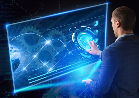 Business, Technology, Internet and network concept. Technology future. Young businessman, working on the smartphone of the future, clicks on the virtual display button