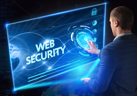 security technology: Business, Technology, Internet and network concept. Technology future. Young businessman, working on the smartphone of the future, clicks on the virtual display button: Web Security
