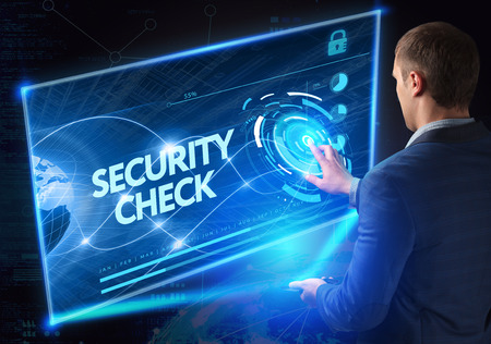 Business, Technology, Internet and network concept. Technology future. Young businessman, working on the smartphone of the future, clicks on the virtual display button: Security Check