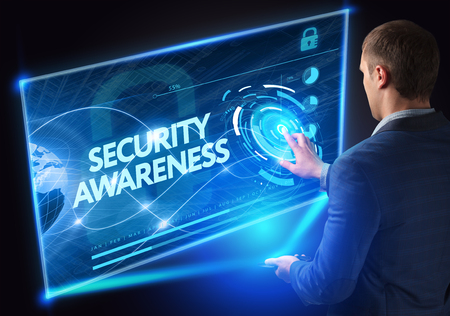 Business, Technology, Internet and network concept. Technology future. Young businessman, working on the smartphone of the future, clicks on the virtual display button: Security Awareness