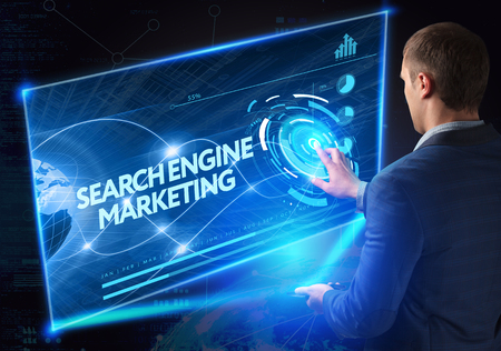 Business, Technology, Internet and network concept. Technology future. Young businessman, working on the smartphone of the future, clicks on the virtual display button: Searchengine Marketing Stock Photo