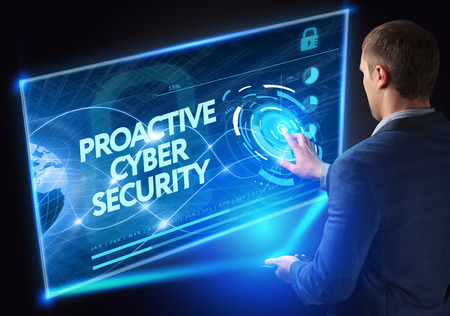 Business, Technology, Internet and network concept. Technology future. Young businessman, working on the smartphone of the future, clicks on the virtual display button: Proactive Cyber Security