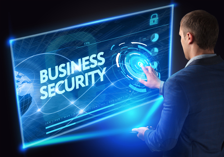 business security: Business, Technology, Internet and network concept. Technology future. Young businessman, working on the smartphone of the future, clicks on the virtual display button: Business Security