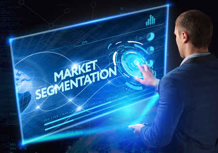 technology market: Business, Technology, Internet and network concept. Technology future. Young businessman, working on the smartphone of the future, clicks on the virtual display button: Market Segmentation Stock Photo