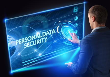 Business, Technology, Internet and network concept. Technology future. Young businessman, working on the smartphone of the future, clicks on the virtual display button: Personal Data Security