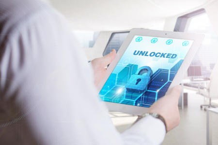 unlocked: Business, Technology, Internet and network concept. Young business man, working on the tablet of the future, select on the virtual display: Unlocked Stock Photo