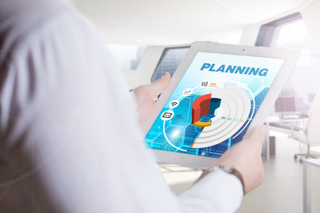 planing: Business, Technology, Internet and network concept. Young business man, working on the tablet of the future, select on the virtual display: Planing