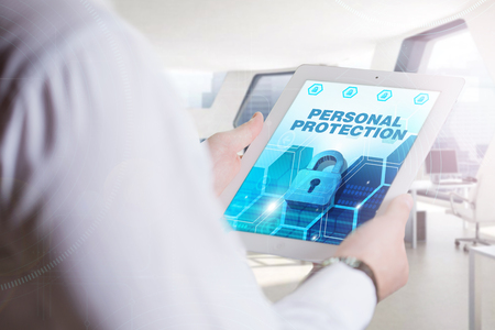 elementos de protecci�n personal: Business, Technology, Internet and network concept. Young business man, working on the tablet of the future, select on the virtual display: Personal Protection