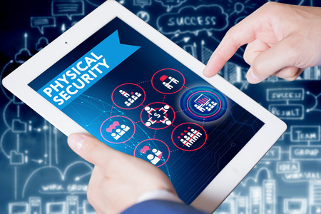 security icon: Business, Technology, Internet and network concept. Young businessman, working on the tablet , select on the virtual display: Physical security