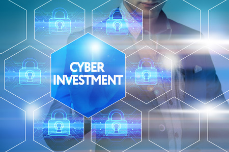 cyber defence: Business, technology, internet and networking concept. Businessman presses a button on the virtual screen: cyber investment