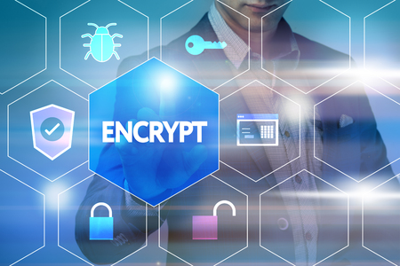 cyber defence: Business, technology, internet and networking concept. Businessman presses a button on the virtual screen: Encrypt Stock Photo