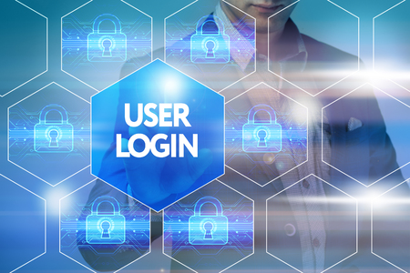 cyber defence: Business, technology, internet and networking concept. Businessman presses a button on the virtual screen: User login