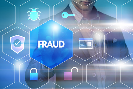 cyber defence: Business, technology, internet and networking concept. Businessman presses a button on the virtual screen: Fraud Stock Photo