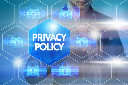 Business, technology, internet and networking concept. Businessman presses a button on the virtual screen: Privacy policy Stock Photo
