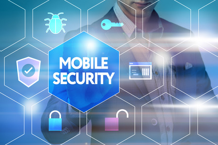 cyber defence: Business, technology, internet and networking concept. Businessman presses a button on the virtual screen: Mobile security Stock Photo