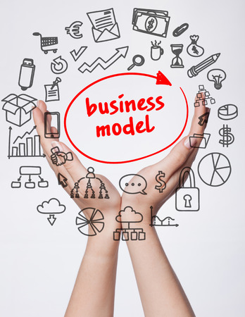 Technology, internet, business and marketing. Young business woman writing word:business model Stockfoto