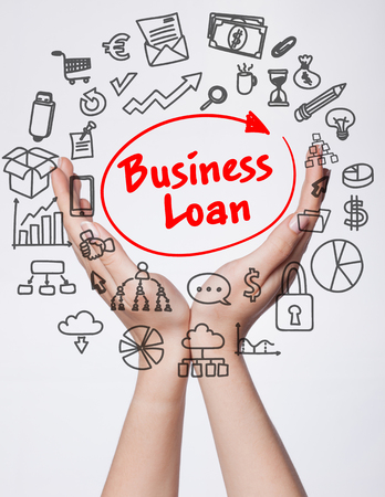 Technology, internet, business and marketing. Young business woman writing word: business loan