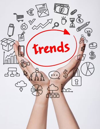 Technology, internet, business and marketing. Young business woman writing word: Trends