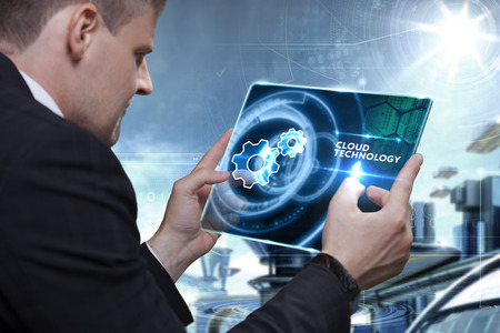 technologist: Business, Technology, Internet and network concept. Businessman working on the tablet of the future, select on the virtual display: cloud technology