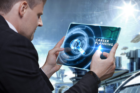 technology career: Business, Technology, Internet and network concept. Businessman working on the tablet of the future, select on the virtual display: career planning