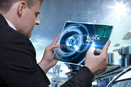 interstitial: Business, Technology, Internet and network concept. Businessman working on the tablet of the future, select on the virtual display: block ads Stock Photo
