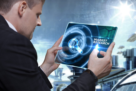 technology market: Business, Technology, Internet and network concept. Businessman working on the tablet of the future, select on the virtual display: Market research Stock Photo