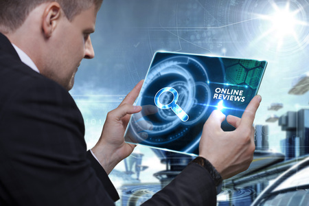 reviewer: Business, Technology, Internet and network concept. Businessman working on the tablet of the future, select on the virtual display: online reviews