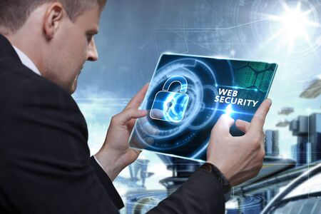 identifying: Business, Technology, Internet and network concept. Businessman working on the tablet of the future, select on the virtual display: Web security