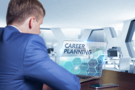 technology career: Business, Technology, Internet and network concept. Business man working on the tablet of the future, select on the virtual display: career planning Stock Photo