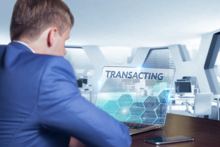 transact: Business, Technology, Internet and network concept. Business man working on the tablet of the future, select on the virtual display: Transacting
