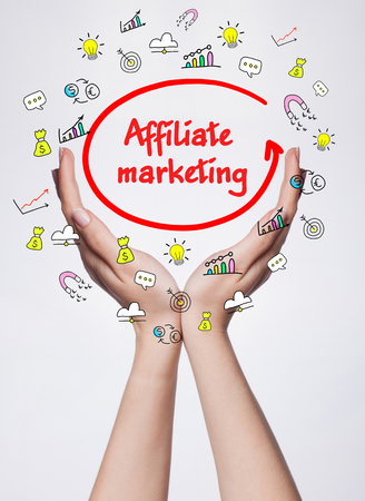 affiliate marketing: Technology, internet, business and marketing. Young business woman writing word: Affiliate marketing
