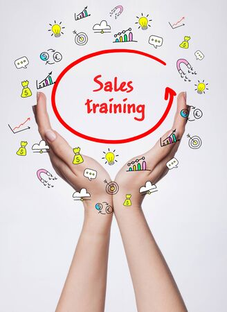 Technology, internet, business and marketing. Young business woman writing word: Sales training Standard-Bild