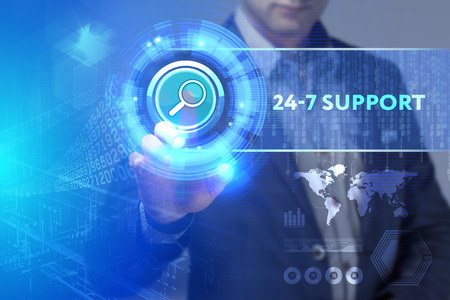 24x7: Business, Technology, Internet and network concept. Business man working on the tablet of the future, select on the virtual display: 24-7 Support Stock Photo