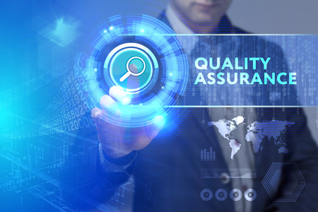 Business, Technology, Internet and network concept. Business man working on the tablet of the future, select on the virtual display: Quality assurance