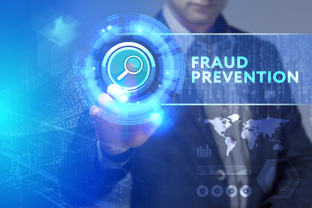 Business, Technology, Internet and network concept. Business man working on the tablet of the future, select on the virtual display: Fraud prevention