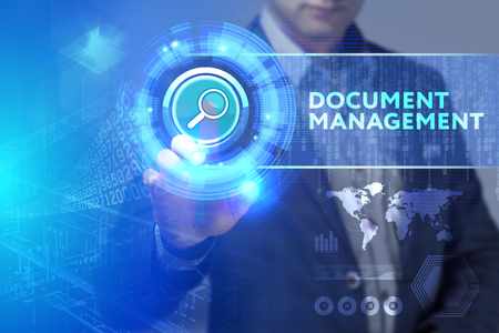 Business, Technology, Internet and network concept. Business man working on the tablet of the future, select on the virtual display: Document management