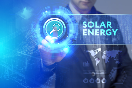 Business, Technology, Internet and network concept. Business man working on the tablet of the future, select on the virtual display: Solar energy